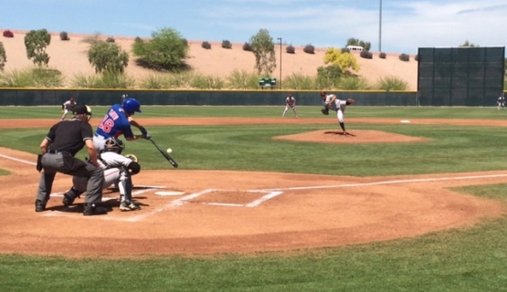 "Luis Ysla delivers a pitch in the first inning of today's ""High-A"" exhibition game between the Giants and Cubs"